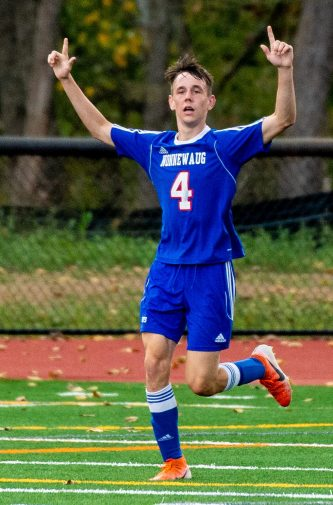 Nonnewaug's Zach Thompson (4) celebrates his second goal of the game against Thomaston Tuesday on the new turf field at Nonnewaug High School. Jim Shannon Republican-American