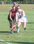 Lewis Mills High School's Morgan O'Regan battles Wamogo High School's Sydney Marhefsky for the ball during the girls varsity field hockey game at Lewis Mills on Wednesday afternoon. Emily J. Tilley. Republican-American