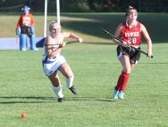 Lewis Mills High School's Sydney Minella races Wamogo High School's Julia Churyk for the ball during the girls varsity field hockey game at Lewis Mills on Wednesday afternoon. Emily J. Tilley. Republican-American