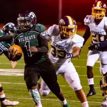 Wilby's Rakwon James (1) runs for a first down after getting back Kennedy's Kelvin Hernandez (33) during their game Friday at Crosby High School. Jim Shannon Republican-American