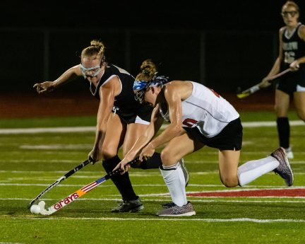 Pomperaug's Jessica Evans (40), right, and Joel Barlow's Ashley Starrett (5) battle for control of the ball, during a SWC girls field hockey game between Joel Barlow and Pomperaug at Pomperaug High School on Wednesday. Bill Shettle Republican-American