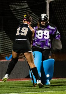 Pomperaug goalie Madison Burstiner (99) makes a save in front of the goal on Joel Barlow's Bella Miceli (19), during a SWC girls field hockey game between Joel Barlow and Pomperaug at Pomperaug High School on Wednesday. Bill Shettle Republican-American