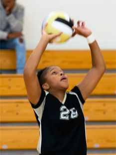 WCA's Jada Howard (26) sets the ball during their NVL match-up with Naugatuck Tuesday at Waterbury Career Academy. Jim Shannon Republican-American