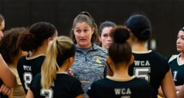 WCA girls volleyball head coach Sara Paradis, talks with her players during time out in their NVL match-up with Naugatuck Tuesday at Waterbury Career Academy. Jim Shannon Republican-American