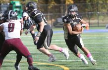 #1 Cyris Smith of Waterbury Career Academy makes his way around the corner as he gains yardage against Torrington High during football action in Waterbury Thursday. Steven Valenti Republican-American
