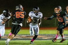 Ansonia running back Shykeem Harmon #3 runs with the ball up the middle against Watertown's Owen Munson (85) and Anthony Velardi (33), during a NVL game of the unbeaten between Ansonia and Watertown at Watertown High School on Friday. Bill Shettle Republican-American