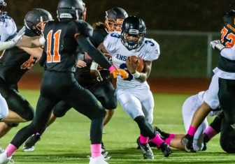 Ansonia running back Shykeem Harmon #3 runs with the ball through a big hole towards Watertown's Leo Kolonsky (11) defending, during a NVL game of the unbeaten between Ansonia and Watertown at Watertown High School on Friday. Bill Shettle Republican-American