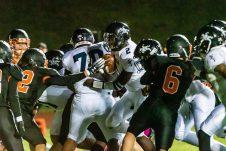 Ansonia quarterback Sheldon Schuler #2, center, runs with ball on a quarterback keeper for a touchdown, during a NVL game of the unbeaten between Ansonia and Watertown at Watertown High School on Friday. Bill Shettle Republican-American