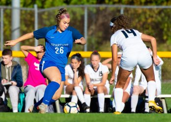 Lewis Mills' Makayla Issakhani (26) looks to get around Newington's Alexi Armour (14) during their game Tuesday at Nassahegan Field in Burlington. Jim Shannon Republican-American