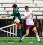 Wilby's Gerrson Coello (8) clears the ball in front of Sacred Heart's Danny Mara (11) during their NVL game Thursday at Municipal Stadium in Waterbury. Jim Shannon Republican-American