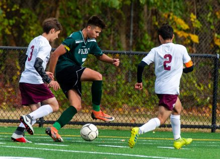 Wilby's Almin Cecunjann (7) pushes the ball up field past Sacred Heart's Jacob Grendzinski (3) and Eddy Romero (2) during their NVL game Thursday at Municipal Stadium in Waterbury. Jim Shannon Republican-American
