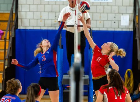 Nonnewaug's Abby Scheurich (3) tips the ball over the net past Northwestern's Skylar Dimartino (11) during their Berkshire League match up Tuesday at Woodbury Middle School. Jim Shannon Republican-American