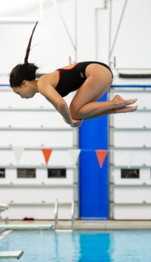 Cheshire's Hannah Tao completes her dive during their meet with Lauralton Hall Tuesday at the Cheshire Community Pool. Jim Shannon Republican-American