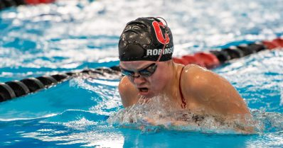 Cheshire's Abigail Robinson competes in the 100 Yard Breaststroke during their meet with Lauralton Hall Tuesday at the Cheshire Community Pool. Jim Shannon Republican-American