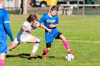 Housatonic Valley's Luke Mollica (16), left, and Gilbert's Mitch Neag (7) battle for the ball, during a Boys BL soccer game between Housatonic Valley Regional and Gilbert at Walker Field in Winsted on Wednesday. Bill Shettle Republican-American