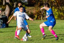 Housatonic Valley's Lucas Calhoun (10), left, controls the ball in front of Gilbert defender Sean Smith (13), right, during a Boys BL soccer game between Housatonic Valley Regional and Gilbert at Walker Field in Winsted on Wednesday. Bill Shettle Republican-American