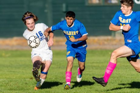 Housatonic Valley's Luke Mollica (16), left, clears the ball away from Gilbert defenders Aqeel Hadash (15), center and a charging Bajram Gutic (22), during a Boys BL soccer game between Housatonic Valley Regional and Gilbert at Walker Field in Winsted on Wednesday. Bill Shettle Republican-American