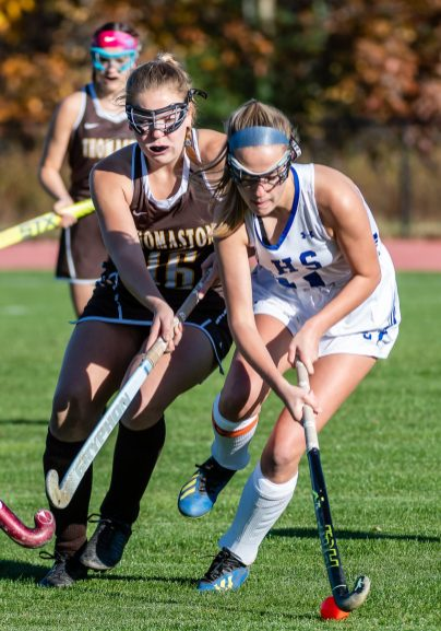 Thomaston's Emma Sanson (16), left, tries to track down Litchfield's Brook Small (11) for control of the ball, during a girls BL field hockey match between Thomaston and Litchfield at Litchfield High School in Litchfield on Thursday. Bill Shettle Republican-American