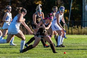 Thomaston's Hannah Laone (13), center, winds up to take a shot on goal in front of Litchfield defender Savannah Leigh (1), during a girls BL field hockey match between Thomaston and Litchfield at Litchfield High School in Litchfield on Thursday. Bill Shettle Republican-American