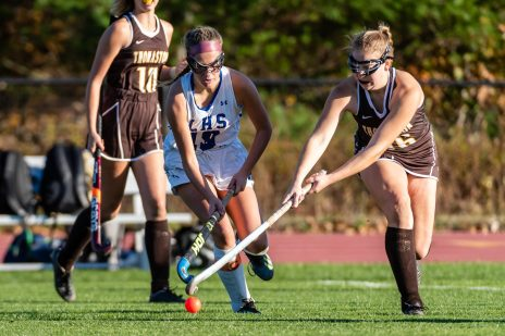 Litchfield's Casey Small (19), left, and Thomaston's Emma Sanson (16) battle for possession of the ball, during a girls BL field hockey match between Thomaston and Litchfield at Litchfield High School in Litchfield on Thursday. Bill Shettle Republican-American
