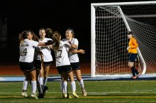 Woodland's Aries Bell (7), second from right, celebrates her scoring of the first goal with Holly Plasky (14), and Jillian O'Neil (17) along with other teammates, during a girls NVL soccer match between Woodland Regional and Oxford at Oxford High School in Oxford on Thursday. Bill Shettle Republican-American