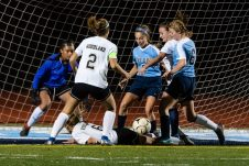 Woodland goalkeeper Isabella Mejias, left, and teammate Olivia Kotsafts (2) along with Oxford's Grace Mahmood (2) and Kate Wickenheisser (6) stand over Woodland's Jenna Mierek (6), center, as she lies on the ground in front of the goal with the ball on the back of her legs, during a girls NVL soccer match between Woodland Regional and Oxford at Oxford High School in Oxford on Thursday. Bill Shettle Republican-American
