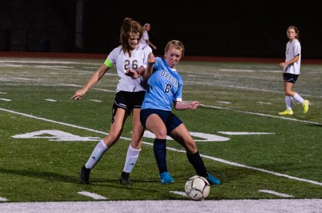 Woodland's Molly Hussey (26), left, and Oxford's Kate Wickenheisser (6) battle for the ball along the sidelines, during a girls NVL soccer match between Woodland Regional and Oxford at Oxford High School in Oxford on Thursday. Bill Shettle Republican-American
