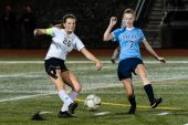 Woodland's Molly Hussey (26) clears the ball way from Oxford defender Sarah Courtney (7), during a girls NVL soccer match between Woodland Regional and Oxford at Oxford High School in Oxford on Thursday. Bill Shettle Republican-American