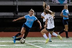 Oxford's Jess Kondic (8), left, puts a move on Woodland's Jillian O'Neil (17), during a girls NVL soccer match between Woodland Regional and Oxford at Oxford High School in Oxford on Thursday. Bill Shettle Republican-American
