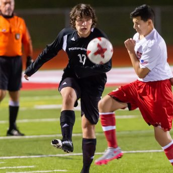Pomperaug's Charlie DePinho (13) clears the ball in front of Stratford's Andres Jimenez (10) during their SWC game Tuesday at Pomperaug High School. Jim Shannon Republican-American