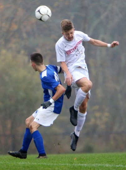 #19 Dante Bottalico of Northwestern heads ball as #10 Luke Parsons of Litchfield High defends during soccer action in Litchfield Tuesday. Steven Valenti Republican-American