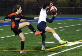 #1 Tori DiStefano of Watertown High kicks ball past #12 Ambria Gil of Oxford High during the NVL soccer tournament semifinals at Municipal Stadium in Waterbury Monday. Steven Valenti Republican-American