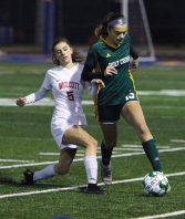 #5 Jenna Tracey of Wolcott High and #13 Devon Bushka of Holy Cross High battle for the ball during the NVL soccer tournament semifinals at Municipal Stadium in Waterbury Monday. Steven Valenti Republican-American