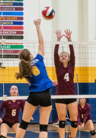 Naugatuck's Hailey Russell (4) goes up to block the spike of Seymour's Jasmine Franco (8), during the NVL Girls Volleyball Tournament final between Naugatuck and Seymour at Kennedy High School on Wednesday. Bill Shettle Republican-American