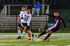 Naugatuck's Lucas Silva (7), right, shoots and scores a goal with Woodland's Jack Schwarz (13) defending, during the NVL Boys Soccer final between Naugatuck and Woodland at Municipal Stadium in Waterbury on Thursday. The Naugatuck boys soccer team are the 2019 NVL Champions after beating Woodland 2-1. Bill Shettle Republican-American