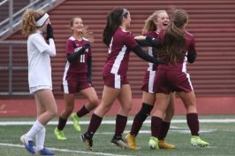 Naugatuck High players celebrate their first half goal against Rockville High during the first round of Class L girls soccer tournament in Naugatuck Tuesday. Steven Valenti Republican-American