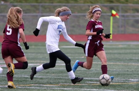 #10 Rebecca Opdenbrouw of Rockville High tries to keep the ball for #3 Allison Murphy and #5 Paige Cruz of Naugatuck High during the first round of Class L girls soccer tournament in Naugatuck Tuesday. Steven Valenti Republican-American