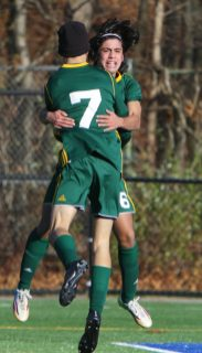 #7 Brian Silva of Holy Cross High celebrates with teammate #6 Jack Villano after scoring a goal against Bolton High in second round of Class S boys soccer tournament at Municipal Stadium in Waterbury Wednesday. Steven Valenti Republican-American