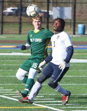 #15 Colin Harrigan of Holy Cross High and #3 Chase Cross of Bolton battle for the ball during the second round of Class S boys soccer tournament at Municipal Stadium in Waterbury Wednesday. Steven Valenti Republican-American