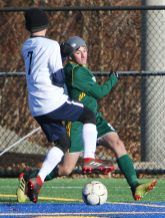 #9 Luciano D'Amelio of Holy Cross tries to score a goal as #7 Aiden Gamache of Bolton High defends during the second round of Class S boys soccer tournament at Municipal Stadium in Waterbury Wednesday. Steven Valenti Republican-American