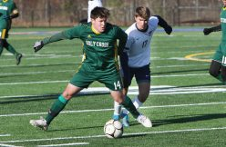 #14 Thomas Pompei of Holy Cross looks to pass up field as #17 Luke Lourenco of Bolton High defends during the second round of Class S boys soccer tournament at Municipal Stadium in Waterbury Wednesday. Steven Valenti Republican-American