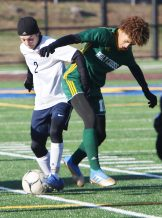 #11 Kadin Talho of Holy Cross High battles for the ball with #2 Joshua Orzolek of Bolton High during the second round of Class S boys soccer tournament at Municipal Stadium in Waterbury Wednesday. Steven Valenti Republican-American