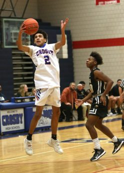 Crosby High School's Jonathan Rivera grabs a rebound during the boys varsity basketball game at Crosby against WCA on Friday night. Emily J. Tilley. Republican-American