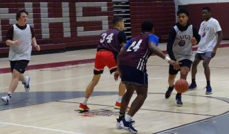 Naugatuck junior Robert Sanders pushes the ball into the lane during last Friday's practice. (Kevin Roberts/RA)