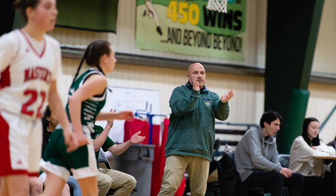 Chase Collegiate's girls basketball coach Bill Maisto applauds the hustle from his team as they took on Master's Saturday at Chase Collegiate. Jim Shannon Republican-American