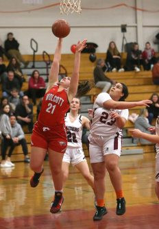 Wolcott High School's Adriana Ferrucci goes up for a shot over Torrington High School's Ashley Davis during the girls varsity basketball game on Thursday night, Feb. 13, 2020. Emily J. Tilley. Republican-American