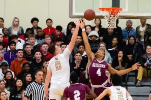 Sacred Heart's Connor Tierney (0) puts up a shot over Naugatuck's Avery Hinnant (4) during their key NVL match-up Friday at Alumni Hall at Sacred Heart High School. Jim Shannon Republican-American
