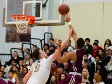 Naugatuck's Avery Hinnant (4) gets a shot off over Sacred Heart's Connor Tierney (0) during their key NVL match-up Friday at Alumni Hall at Sacred Heart High School. Jim Shannon Republican-American