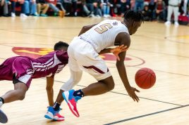 Sacred Heart's Caleb Sampson (5) is fouled by Naugatuck's Ese Onakpoma (2) during their key NVL match-up Friday at Alumni Hall at Sacred Heart High School. Jim Shannon Republican-American