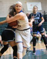 #21 Morgan Teododio of Seymour High controls the rebound against Ansonia High during the NVL Girls Basketball Tournament in Waterbury Saturday. Steven Valenti Republican-American